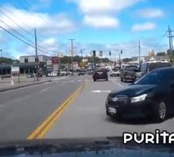 imagen infraccion al lado de un coche policial